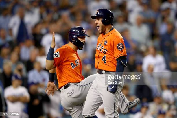 George Springer of the Houston Astros celebrates with Marwin Gonzalez after hitting a tworun home run during the second inning against the Los...