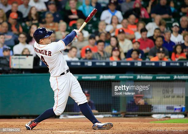 George Springer of the Houston Astros connects on a solo home run in the fifth inning of their game against the Minnesota Twins at Minute Maid Park...