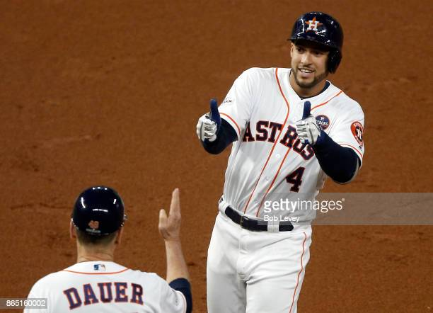 George Springer of the Houston Astros gives a thumbs up to first base coach Rich Dauer after a hit in the first inning against the New York Yankeesin...