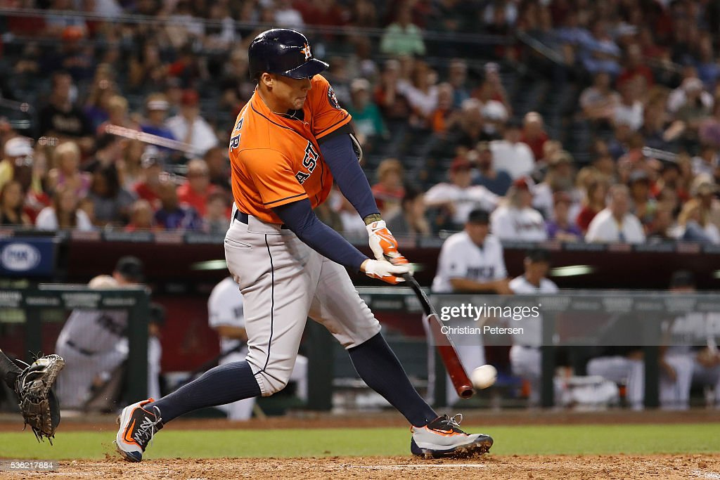 George Springer #4 of the Houston Astros hits a RBI single against the Arizona Diamondbacks during the fourth inning of the MLB game at Chase Field on May 31, 2016 in Phoenix, Arizona.