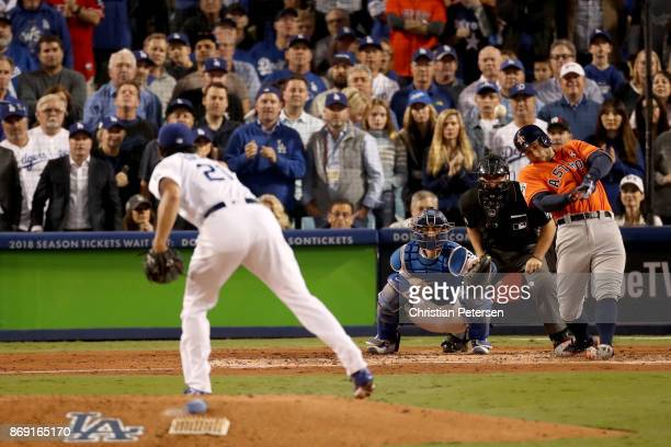 George Springer of the Houston Astros hits a tworun home run during the second inning against the Los Angeles Dodgers in game seven of the 2017 World...