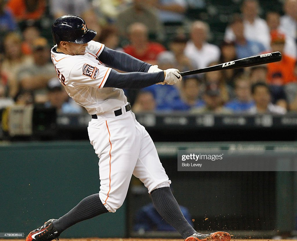 George Springer of the Houston Astros hits a tworun home run in the third inning against the Kansas City Royals at Minute Maid Park on June 30 2015...