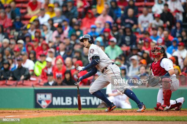 George Springer of the Houston Astros hits an RBI single in the second inning of Game 4 of the American League Division Series against the Boston Red...