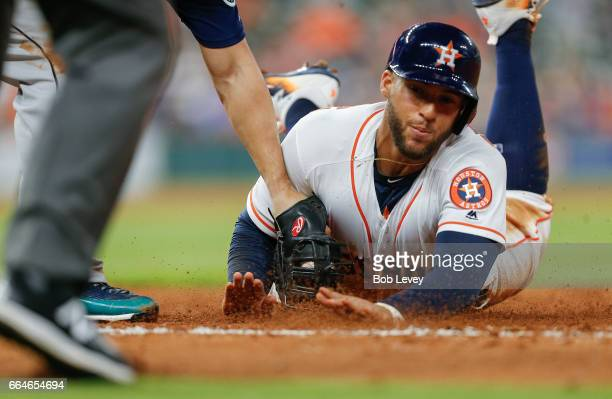 George Springer of the Houston Astros is caught stealing second base against the Seattle Mariners in the sixth inning against the Seattle Mariners at...