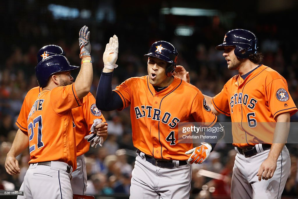 George Springer #4 of the Houston Astros is congratulated by Jose Altuve #27, Jake Marisnick #6 and Lance McCullers #43 after Springer hit a three-run home run against the Arizona Diamondbacks during the second inning of the MLB game at Chase Field on May 31, 2016 in Phoenix, Arizona.