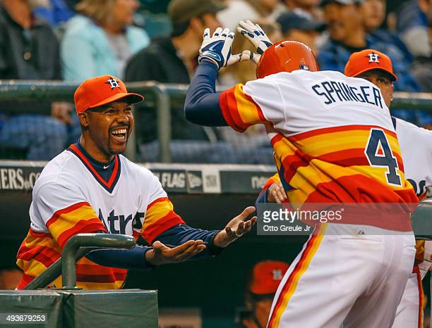 George Springer of the Houston Astros is congratulated by manager Bo Porter after hitting a tworun home run in the fifth inning against the Seattle...