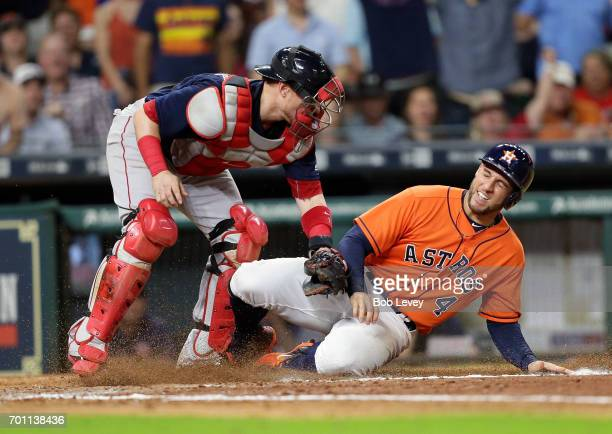 George Springer of the Houston Astros is tagged out by Christian Vazquez of the Boston Red Sox at Minute Maid Park on June 16 2017 in Houston Texas