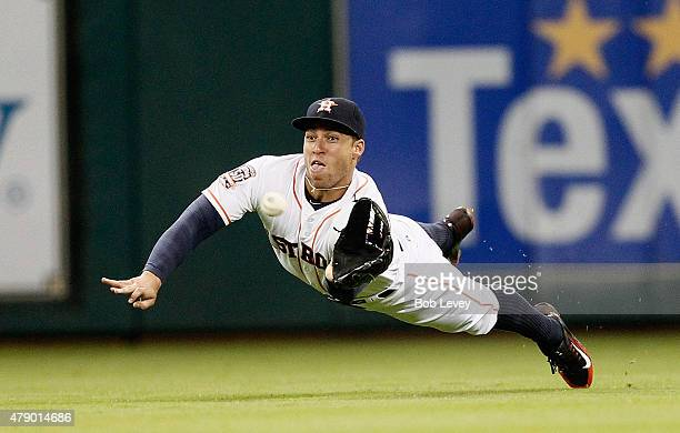 George Springer of the Houston Astros makes a diving catch on al ine drive by Lorenzo Cain of the Kansas City Royals in the third inning at Minute...