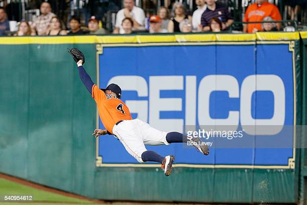 George Springer of the Houston Astros makes a diving catch on line drive by Adam Duvall of the Cincinnati Reds in the sixth inning at Minute Maid...