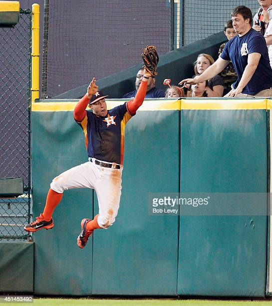 George Springer of the Houston Astros makes a leaping catch at the wall in the sixth inning on a fly ball by Miguel Cabrera of the Detroit Tigers at...