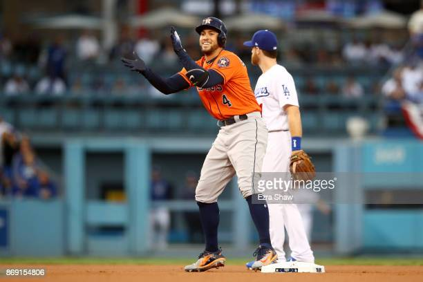 George Springer of the Houston Astros reacts after a double in the first inning against the Los Angeles Dodgers in game seven of the 2017 World...