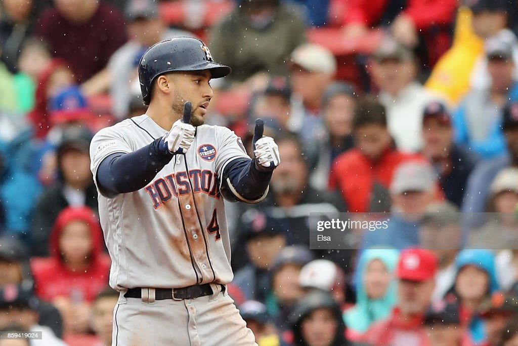 George Springer #4 of the Houston Astros reacts after hitting a RBI single in the second inning against the Boston Red Sox during game four of the American League Division Series at Fenway Park on October 9, 2017 in Boston, Massachusetts.