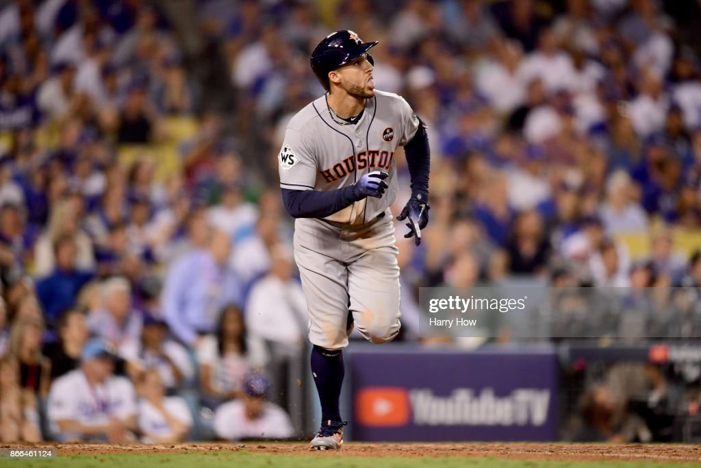 George Springer #4 of the Houston Astros reacts after hitting a two-run home run during the eleventh inning against the Los Angeles Dodgers in game two of the 2017 World Series at Dodger Stadium on October 25, 2017 in Los Angeles, California.