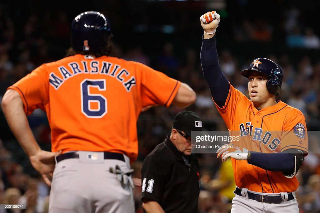 <a gi-track='captionPersonalityLinkClicked' href=/galleries/search?phrase=George+Springer&family=editorial&specificpeople=8060257 ng-click='$event.stopPropagation()'>George Springer</a> #4 of the Houston Astros reacts at home plate after hitting a three-run home run against the Arizona Diamondbacks during the second inning of the MLB game at Chase Field on May 31, 2016 in Phoenix, Arizona.