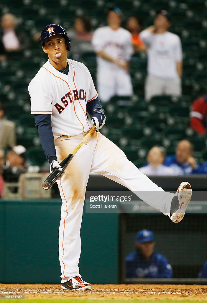George Springer #4 of the Houston Astros reacts to a strike in the 11th inning of their game against the Kansas City Royals at Minute Maid Park on April 16, 2014 in Houston, Texas.