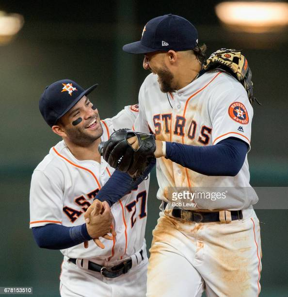 George Springer of the Houston Astros receives a hug from Jose Altuve of the Houston Astros after making a running catch at the wall in the seventh...