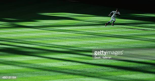 George Springer of the Houston Astros runs after a baseball in right field in the second inning of their game against the Los Angeles Angels of...