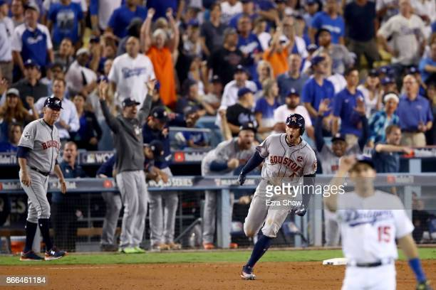 George Springer of the Houston Astros runs the bases after hitting a tworun home run during the eleventh inning against the Los Angeles Dodgers in...