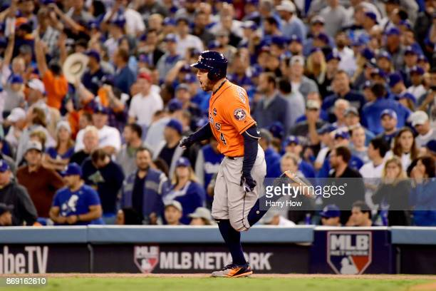 George Springer of the Houston Astros runs the bases after hitting a tworun home run during the second inning against the Los Angeles Dodgers in game...