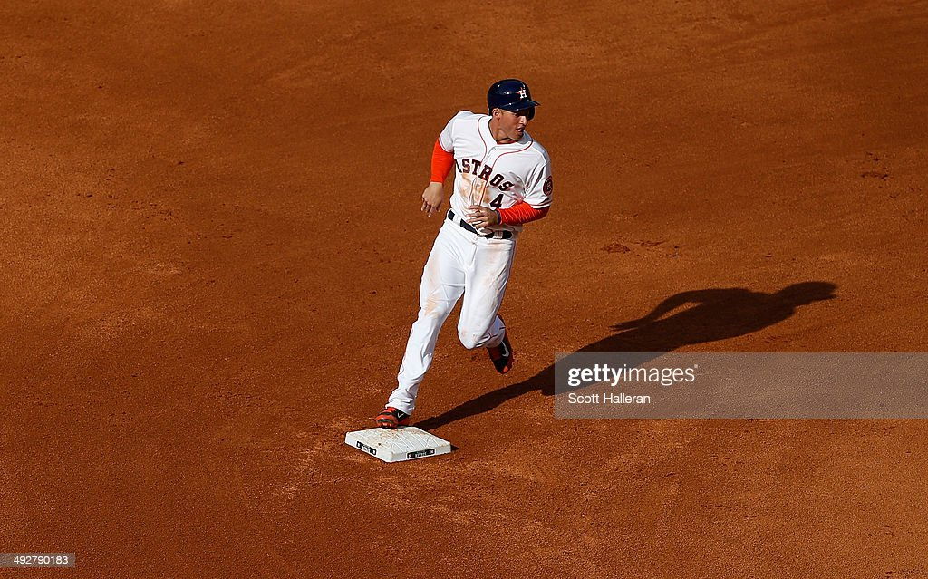 <a gi-track='captionPersonalityLinkClicked' href=/galleries/search?phrase=George+Springer&family=editorial&specificpeople=8060257 ng-click='$event.stopPropagation()'>George Springer</a> #4 of the Houston Astros runs to third base during their game against the Chicago White Sox at Minute Maid Park on May 17, 2014 in Houston, Texas.