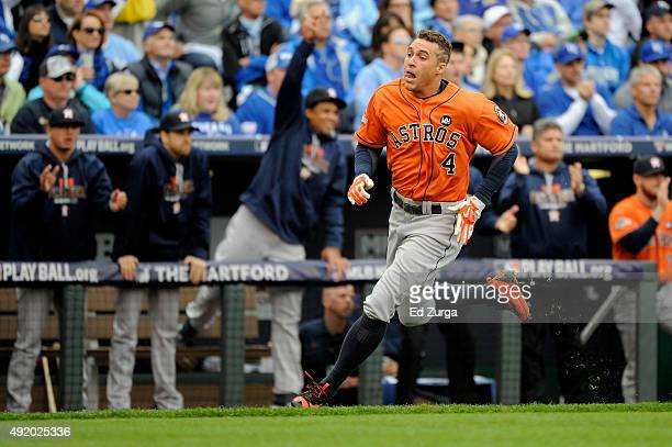 George Springer of the Houston Astros scores a run off of a double hit by Colby Rasmus in the first inning against Johnny Cueto of the Kansas City...