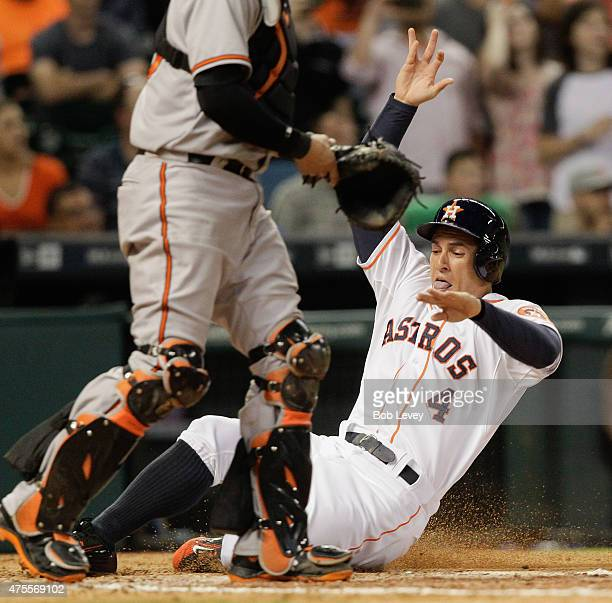 George Springer of the Houston Astros scores on a single by Evan Gattis of the Houston Astros in the seventh inning against the Baltimore Orioles at...
