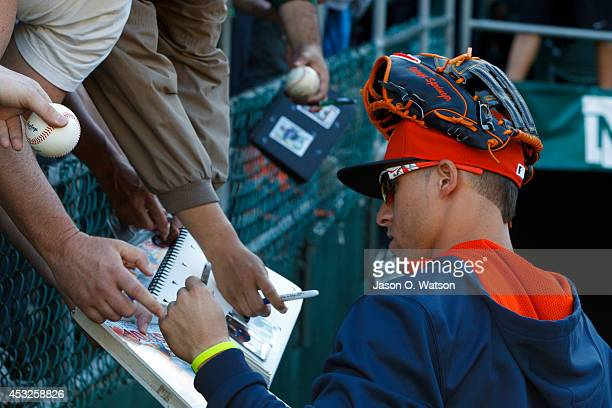 George Springer of the Houston Astros signs autographs during batting practice before the game against the Oakland Athletics at Oco Coliseum on July...