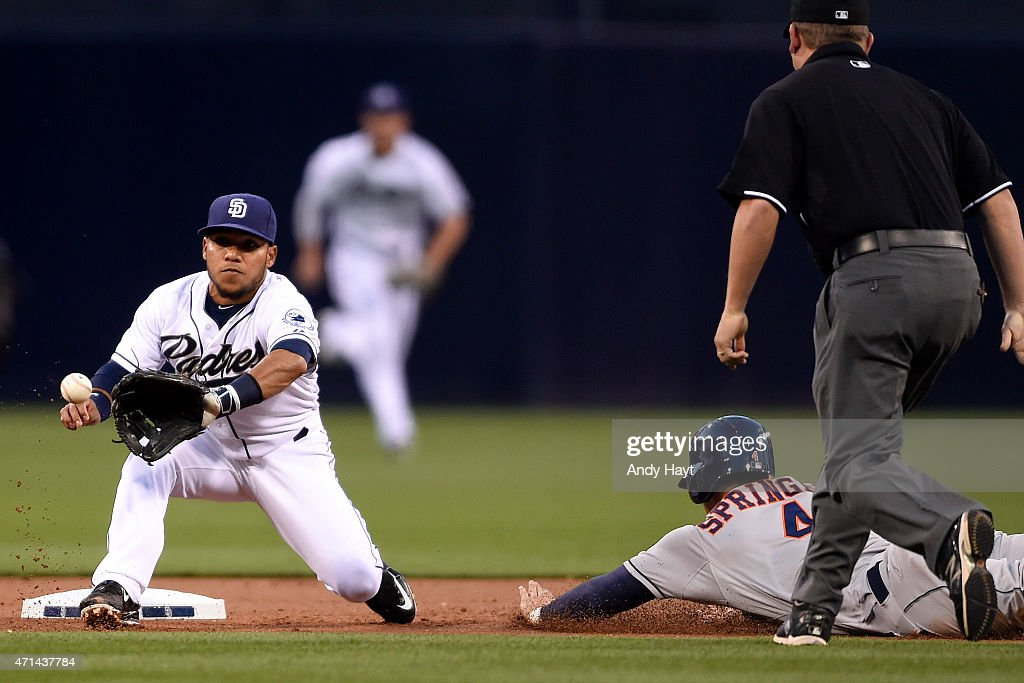 George Springer of the Houston Astros steals second base ahead of the tag of Alexi Amarista of the San Diego Padres during the game at Petco Park on...