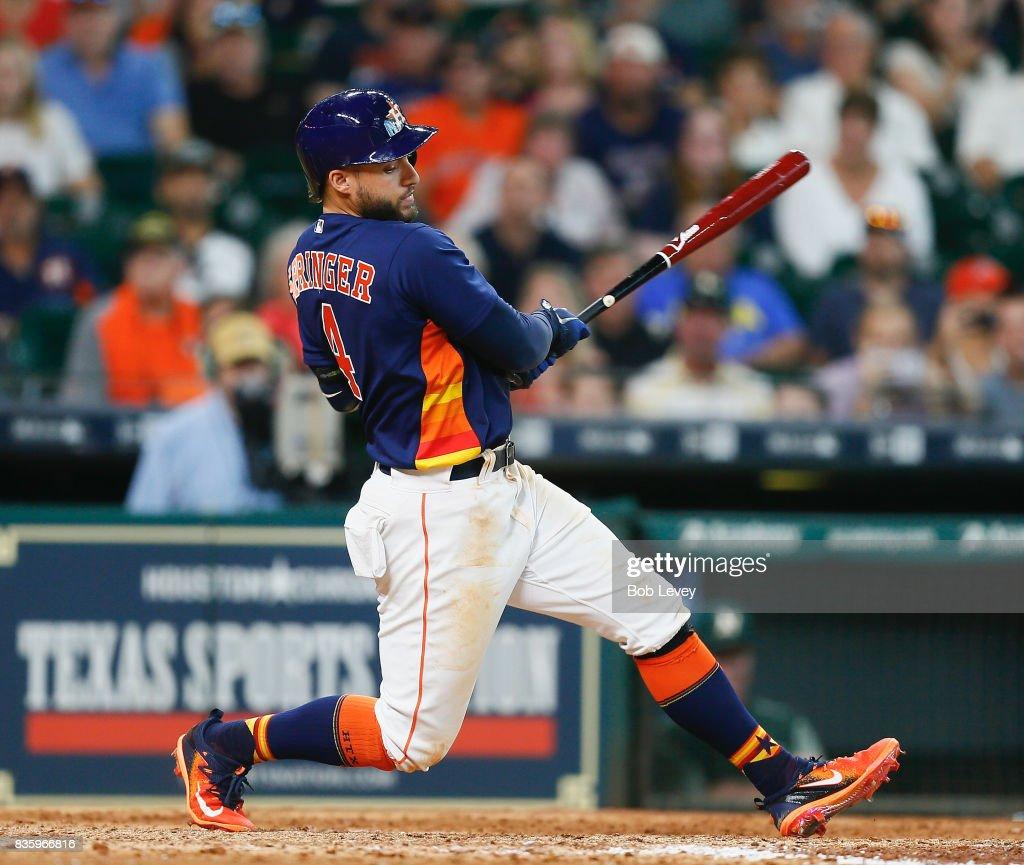George Springer #4 of the Houston Astros strikes out with runners in scoring position in the seventh inning against the Oakland Athletics at Minute Maid Park on August 20, 2017 in Houston, Texas.