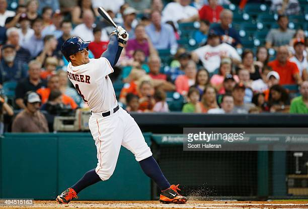 George Springer of the Houston Astros swings at a pitch in the third inning of their game against the Baltimore Orioles at Minute Maid Park on May 29...