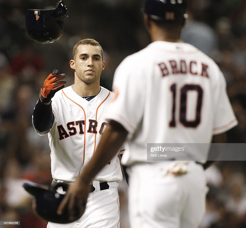 <a gi-track='captionPersonalityLinkClicked' href=/galleries/search?phrase=George+Springer&family=editorial&specificpeople=8060257 ng-click='$event.stopPropagation()'>George Springer</a> #4 of the Houston Astros tosses his helmet after striking out in the fifth inning against the Seattle Mariners at Minute Maid Park on July 1, 2014 in Houston, Texas.