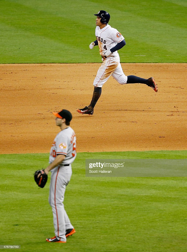 George Springer #4 of the Houston Astros trots around the bases after hitting a solo home run off Miguel Gonzalez of the Baltimore Orioles in the sixth inning during their game at Minute Maid Park on June 3, 2015 in Houston, Texas.