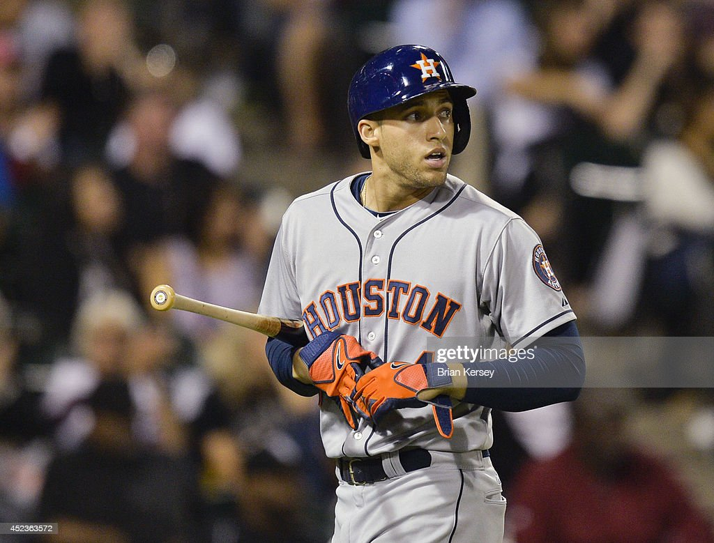 George Springer #4 of the Houston Astros walks off the field after striking out during the ninth inning against the Chicago White Sox at U.S. Cellular Field on July 18, 2014 in Chicago, Illinois. The White Sox defeated the Astros 3-2.