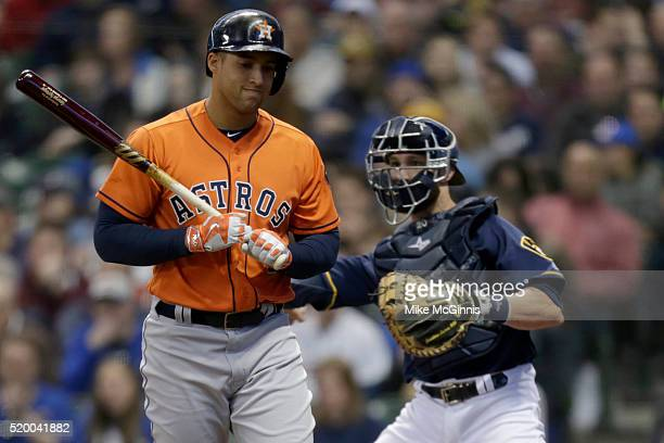 George Springer of the Houston Astros walks to the dugout after striking out in the third inning against the Milwaukee Brewers at Miller Park on...