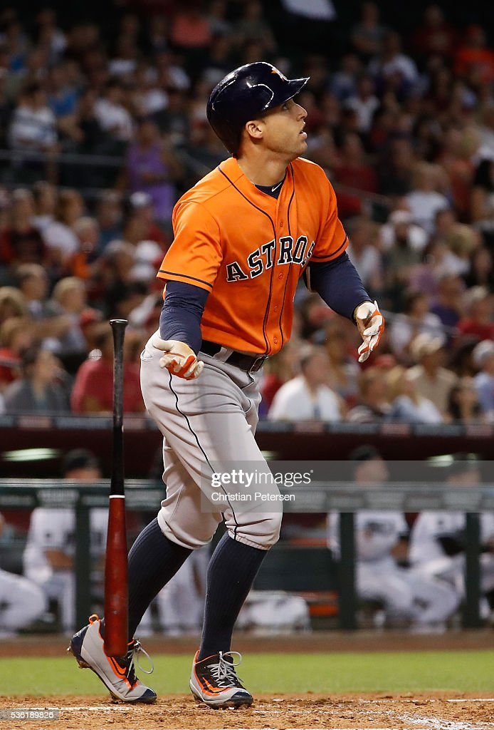 <a gi-track='captionPersonalityLinkClicked' href=/galleries/search?phrase=George+Springer&family=editorial&specificpeople=8060257 ng-click='$event.stopPropagation()'>George Springer</a> #4 of the Houston Astros watches his three-run home run against the Arizona Diamondbacks during the second inning of the MLB game at Chase Field on May 31, 2016 in Phoenix, Arizona.
