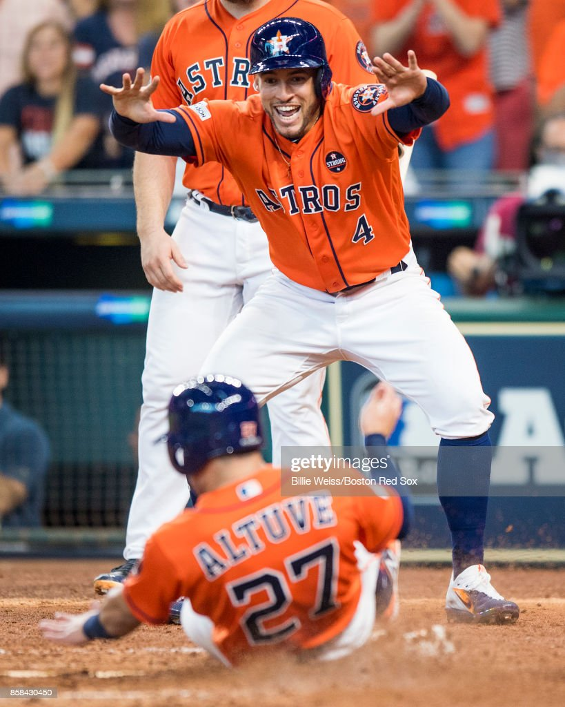 George Springer #4 reacts as Jose Altuve #27 of the Houston Astros scores during the sixth inning of game two of the American League Division Series against the Boston Red Sox on October 6, 2017 at Minute Maid Park in Houston, Texas.