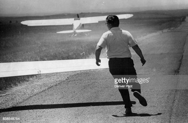 George Sterling runs alongside wing to keep it from tipping as his wife Bert takes off 'When you soar especially when you're taking off you have to...