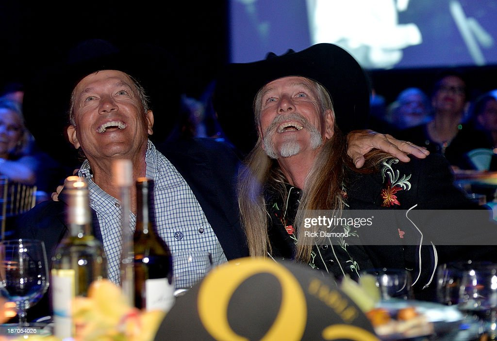 <a gi-track='captionPersonalityLinkClicked' href=/galleries/search?phrase=George+Strait&family=editorial&specificpeople=234588 ng-click='$event.stopPropagation()'>George Strait</a> (L) and Honoree Dean Dillon attend the 61st annual BMI Country Awards on November 5, 2013 in Nashville, Tennessee.