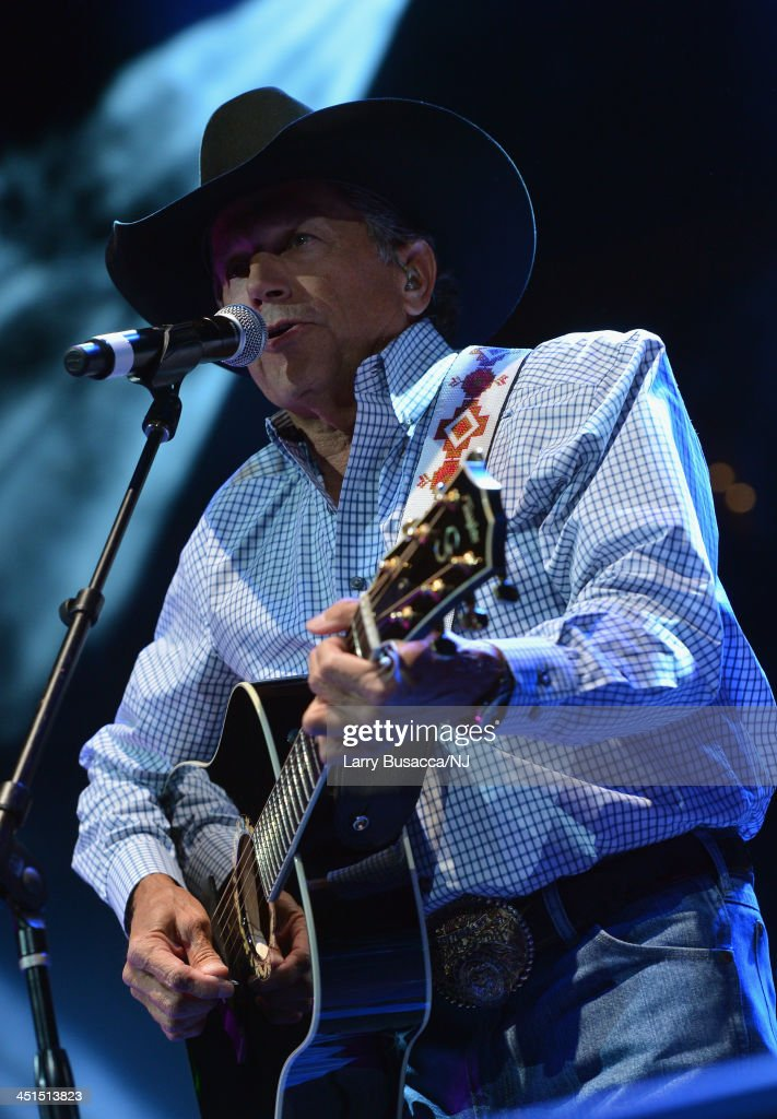 <a gi-track='captionPersonalityLinkClicked' href=/galleries/search?phrase=George+Strait&family=editorial&specificpeople=234588 ng-click='$event.stopPropagation()'>George Strait</a> performs during Playin' Possum! The Final No Show Tribute To George Jones - Show at Bridgestone Arena on November 22, 2013 in Nashville, Tennessee.