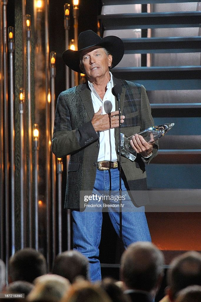 <a gi-track='captionPersonalityLinkClicked' href=/galleries/search?phrase=George+Strait&family=editorial&specificpeople=234588 ng-click='$event.stopPropagation()'>George Strait</a> receives the Entertainer of the Year Award during the 47th annual CMA awards at the Bridgestone Arena on November 6, 2013 in Nashville, Tennessee.
