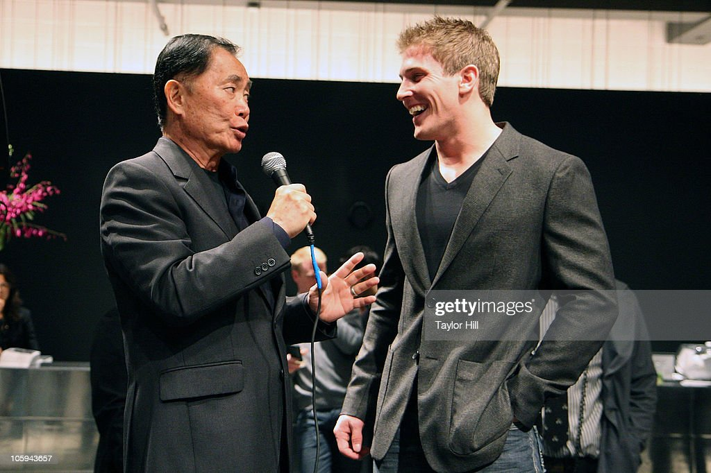George Takei (L) and Scott Herman speak during the Trevor's Fall Fete at Theory Flagship Store on October 21, 2010 in New York City.