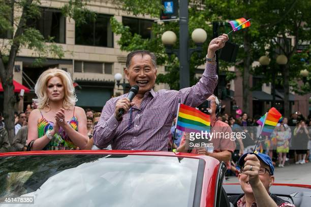George Takei Celebrity Grand Marshall of the 40th Annual Seattle Pride Parade waves from a car on June 29 2014 in Seattle Washington