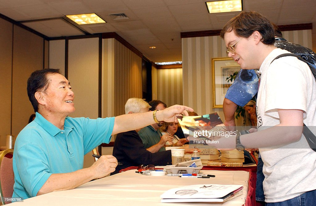 George Takei (Lieutenant Sulu on TV's 'Star Trek') signs autographs for fans. at the Atlanta Marriott Marquis in Atlanta, Georgia