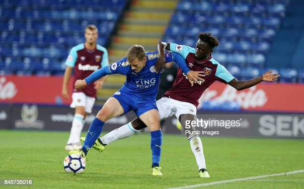 George Thomas of Leicester City in action with Domingos Quina of West Ham United during the Premier League 2 match between Leicester City and West...