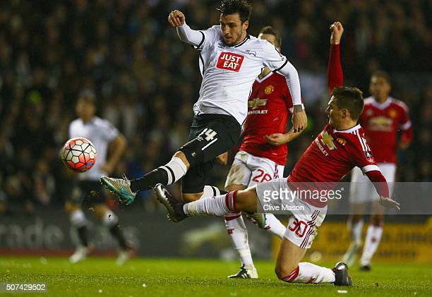 George Thorne of Derby County beats Guilermo Varela of Manchester United to score their first and equalising goal during the Emirates FA Cup fourth...