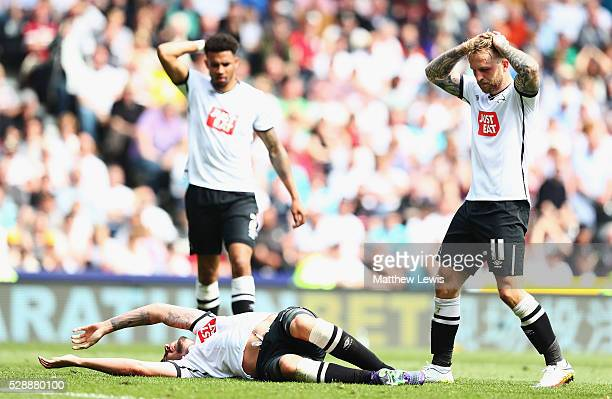 George Thorne of Derby County is injured as Johnny Russell of and Cyrus Christie of Derby County look on during the Sky Bet Championship match...