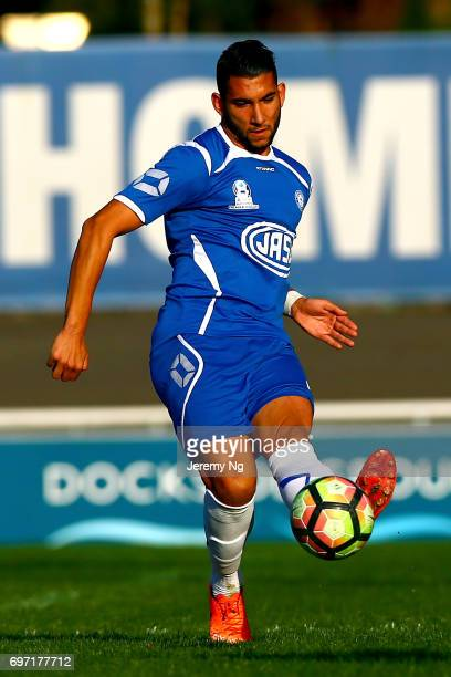 George Timotheou of Olympic FC passes the ball during the NSW NPL Men's match between Sydney Olympic FC and Parramatta FC on June 18 2017 in Sydney...