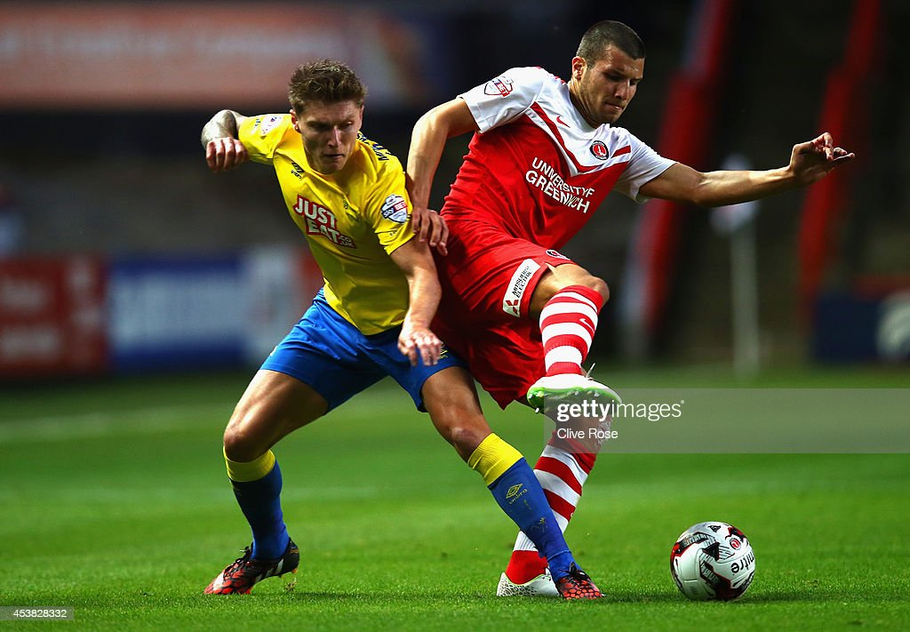 George Tucudean of Charlton is challenged by Craig Bryson of Derby County during the Sky Bet Championship match between Charlton Athletic and Derby County at The Valley on August 19, 2014 in London, England.