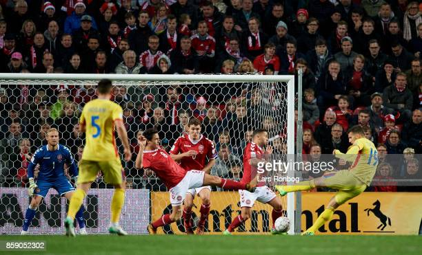 George Tucudean of Romania in action against Thomas Delaney Andreas Christensen and Riza Durmisi of Denmark during the FIFA World Cup 2018 qualifier...