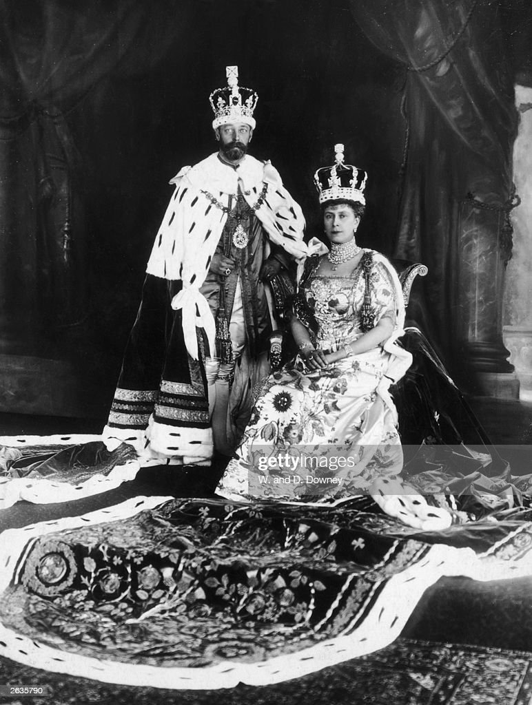George V (1865 - 1936), King of Great Britain, on the day of his coronation, together with his consort Queen Mary (1867 - 1953) in full ceremonial costume and wearing crowns.